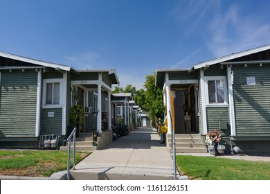 San Pedro, California USA - August 20, 2018: A 1920s vintage Craftsman architectural style Los Angeles bungalow court with a center courtyard walkway has 5 units on each side
