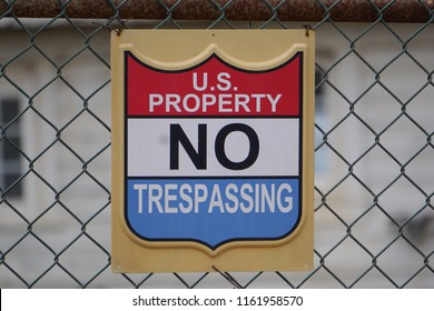 San Pedro, California USA - August 21, 2018: No trespassing sign posted on a fence at a U.S. government coastal facility for the Point Fermin navigation light restricts access.