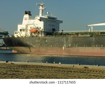 San Pedro, California USA - June 18 2018: Bridge and superstructure at the aft end of an oceangoing oil products tanker in the main channel of the Port of Los Angeles harbor