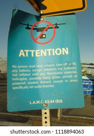 San Pedro, California USA - June 18 2018: Drones prohibited sign with international do not symbol prohibits operation of drones, helicopters or flying objects in a park near the Port of Los Angeles.