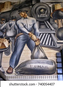 "San Pedro, California USA - October 21, 2017: Detail of U.S. Post office mural ""Mail Transportation"" in WPA modern style by Fletcher Martin, 1935, portrays worker loading mail bags and locomotive."