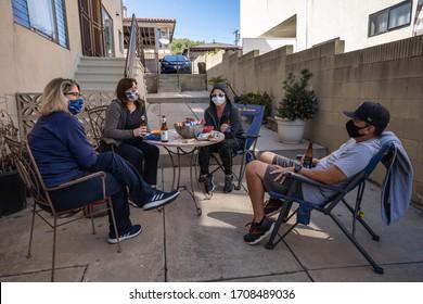 San Pedro, CA/USA - April 19, 2020: social distance party wearing face masks