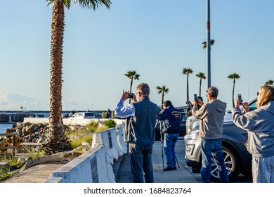 San Pedro, CA/USA - March 27, 2020: USNS Mercy, people photograph the navy hospital ship as it arrives at Port of Los Angeles
