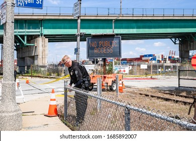San Pedro, CA/USA - March 28, 2020: Police limit access to cruise terminal where USNS Mercy navy hospital ship is docked at Port of Los Angeles in San Pedro, CA
