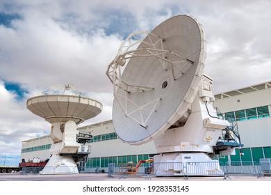 San Pedro de Atacama, Atacama Desert, ALMA Base Camp, Chile – ALMA Base Camp infrastructure and machinery with large radio telescopes.
