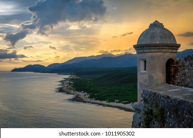 San Pedro de La Roca fort walls and tower, sunset view with sea and Caribbean coastline, Santiago De Cuba, Cuba
