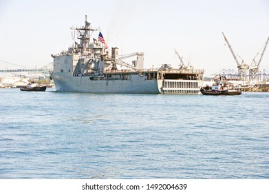 """SAN PEDRO/CALIFORNIA - AUG. 27, 2019: USS Comstock (LSD-45), a dock landing ship arrives at the Port of Los Angeles to celebrate """"Fleet Week"""" the nations' sea services. San Pedro, California USA"""
