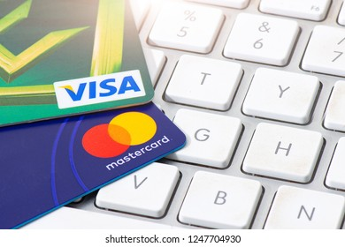 SAN PELLEGRINO TERME, ITALY - NOVEMBER 29, 2018: VISA and MASTERCARD credit cards supported on a computer keyboard