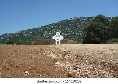San Pietro church on Golgo upland in Sardinia with street zoom