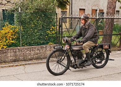 "San Pietro in Trento, Ravenna, Italy - April 13, 2018: rider on a old English motorcycle Norton 16H 500 cc (1922) in classic motorbike rally ""Circuito di San Pietro in Trento"""