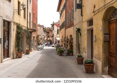 San Quirico d'Orcia, Italy - April 24, 2018: Street view of San Quirico d'Orcia. A small typical town in Italy. Typical Italian street in a small provincial town of Tuscan, Italy.