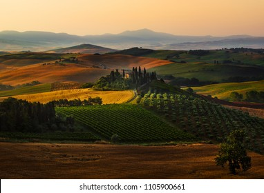SAN QUIRICO d'ORCIA, TUSCANY, ITALY - 06 23 2016: AERIAL VIEW OF BEAUTIFUL LONELY VILLA IN SAN QUIRICO d'ORCIA, TUSCANY, ITALY, EUROPE, NEAR PIENZA. SUNRISE.