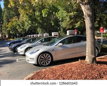 San Ramon , California / USA - 12/2/2018: Tesla Model 3 zero emission electric vehicle or EV charging at a California Supercharger