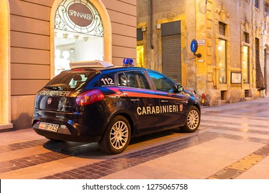 San Remo, Italy – June 24, 2018: Carabinieri car (Fiat Bravo) of Italian municipal police parked at entrance of pedestrian Corso Matteotti street for keeping safety in historic center