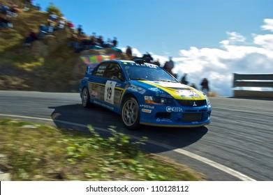 SAN REMO, ITALY - SEPTEMBER 29: Italian rally driver Andrea Perego racing in the 50th Rally di Sanremo. September 29, 2007 in Sanremo, Italy