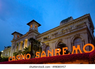 SAN REMO, LIGURIA, ITALY, SEPTEMBER 13: The Municipal Casino with its name in light letters at  the foreground at night in San Remo, Imperia, Italy on September 13, 2016.