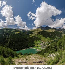 San Rocco, Madesimo, Sondrio, August 8, 2019 - Panoramic view on lake of Isola, taken from SS36 Lake Como and Spluga State Road. Panorama obtained by merging together 12 photos.