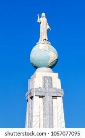 SAN SALVADOR, EL SALVADOR - FEB 2, 2018: Jesus Crist stutue on the globe (Monument to the Divine Savior of the World), San Salvador, El Salvador, Central America