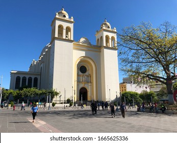 San Salvador / El Salvador - February 16 2020: Metropolitan Cathedral Of San Salvador in the central square. Religious building with two towers and blue sky. Roman catholic Archdiocese.