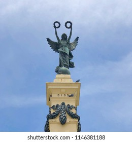 SAN SALVADOR, EL SALVADOR -  July 29, 2018: Square photo of the 1911 monument to the Heroes (Monumento a los Próceres) in Liberty Square (Plaza Libertad), depicting an angel with two laurel wreaths.