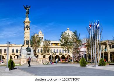 SAN SALVADOR, EL SALVADOR: La Libertad Plaza in San Salvador with the Cathedral on the background on Feb 2, 2018 in San Salvador, Central America.