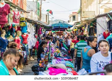San Salvador, El Salvador. March 2018. A view of a typical scene in plaza barrio in San Salvador.