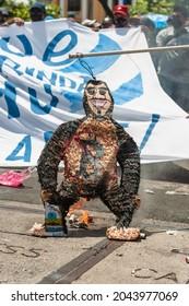 San Salvador, El Salvador - September 15th, 2021: Protesters burn a piñata with the face of current president Nayib Bukele.