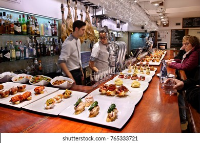 "SAN SEBASTIAN, BASQUE COUNTRY, SPAIN- December 17, 2015. Pintxos - Tapas bar (called ""Nagusia Lau"") in the old part (""Parte Vieja"") of the city"