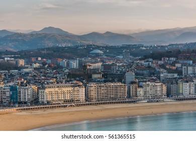 San Sebastian beach, city an dmountains in background at winter sunset