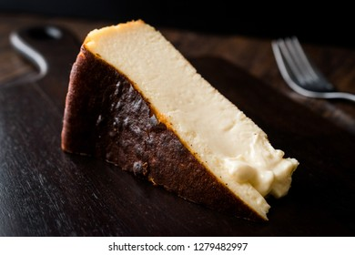 San Sebastian Cheesecake on Wooden Surface / Creamy Plain New York Style. Organic Dessert.