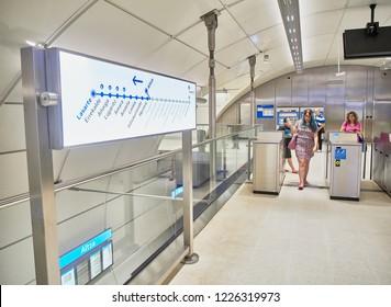 San Sebastian, Spain - August 18, 2018. Passengers accessing to a subway Metro station of Euskotren, also know as Topo. San Sebastian, Gipuzkoa, Basque Country, Spain.