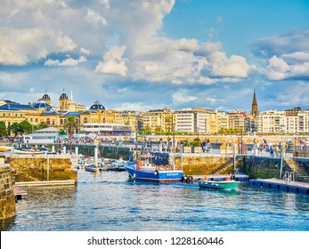 San Sebastian, Spain - August 18, 2018. The port of San Sebastian with the downtown in background at sunny day. Donostia, Basque Country, Guipuzcoa. Spain.