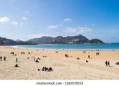 SAN SEBASTIAN, SPAIN - CIRCA MARCH 2017: Unidentified people on La Concha Beach by the city centre