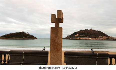 SAN SEBASTIAN, SPAIN - DECEMBER 22: Monument to Fleming sculpture in San Sebastian, Spain on December 22, 2018. It was designed by Eduardo Chillida and it is located in La Concha beach.