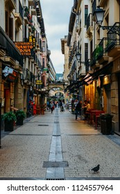 San Sebastian, Spain - June 13, 2018: Crowd of people walk in the shopping streets of San Sebastian, Spain, a resort town on the Bay of Biscay