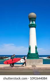 San Sebastian, Spain - May 11, 2018. Surfers with their surfboards crossing Kursaal bridge in San Sebastian at sunny day. Donostia, Guipuzcoa. Spain.