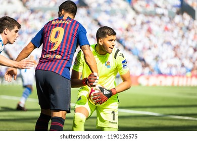 SAN SEBASTIAN, SPAIN - SEPTEMBER 15, 2018: Luis Suarez, Barcelona player and Gero Rulli, Real Sociedad goalkeeper, during a Spanish League match between Real Sociedad and Barcelona