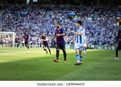 SAN SEBASTIAN, SPAIN - SEPTEMBER 15, 2018: Luis Suarez (L) of Barcelona and Aritz Elustondo (R) of Real Sociedad in action during a Spanish League match between Real Sociedad and Barcelona