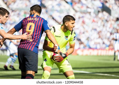 SAN SEBASTIAN, SPAIN - SEPTEMBER 15, 2018: Luis Suarez (L) Barcelona player and Gero Rulli (R) Real Sociedad goalkeeper in action during a Spanish League match between Real Sociedad and Barcelona