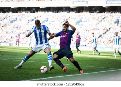 SAN SEBASTIAN, SPAIN - SEPTEMBER 15, 2018: Luis Suarez (R) and Theo Fernandez (L) dispute the ball during a Spanish League match between Real Sociedad and Barcelona