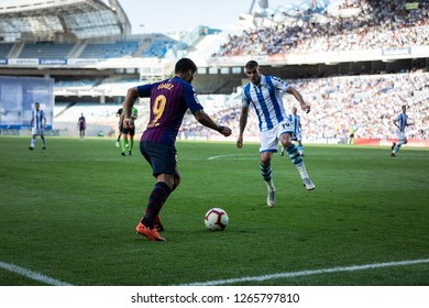 SAN SEBASTIAN, SPAIN - SEPTEMBER 15, 2018: Luis Suarez (L) and Theo Hernandez (R) dispute the ball during a Spanish League, La Liga, match between Real Sociedad and Barcelona