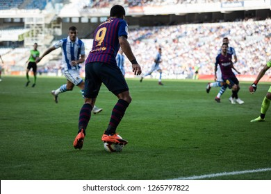SAN SEBASTIAN, SPAIN - SEPTEMBER 15, 2018: Luis Suarez, FC Barcelona player, in acction during a Spanish League, La Liga, match between Real Sociedad and Barcelona