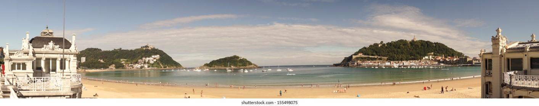 "SAN SEBASTIAN, SPAIN - SEPTEMBER 2013.  Panoramic view of ""La Concha"" beach at the touristical city on the Cantabric Sea."
