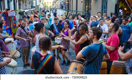 San Telmo, Buenos Aires - Nov 15 2016. The famed San Telmo street market where Argentines gather to dance, drink and enjoy when the street is closed to traffic on Sunday. Drum and dancing is popular.