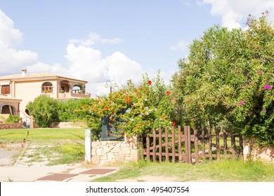 SAN TEODORO, ITALY is typical seaside Sardinian town. villas for rent homes, cute Italian street