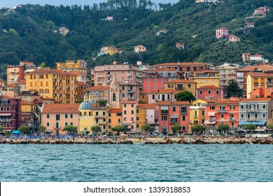 SAN TERENZO, LERICI, ITALY - JULY 28, 2014: San Terenzo beach, crowded with bathers in a July evening. Lerici, in the Gulf of La Spezia, Liguria, Italy, Europe