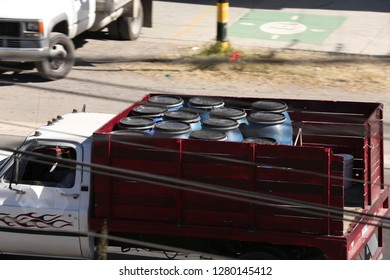 "San Martín Texmelucan, Puebla. Mexico January 8 2019. Clandestine transport of containers with stolen fuel by the so called ""Huachicoleros"" to sell it al economic prices."