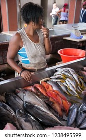 San Vicente, Cape Verde - September 29, 2015: Woman fish vendor inside the Peixe market in the city of Mindelo, capital of the island