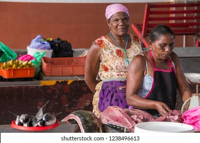 San Vicente, Cape Verde - September 29, 2015: Older women selling fish inside the Peixe market in the city of Mindelo, capital of the island