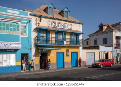 San Vicente, Cape Verde - September 29, 2015: Old colorful colonial houses in the maritime avenue of the city of MIndelo, at sunset